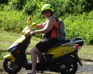 Rosemary has hired a scooter to get around rarotonga