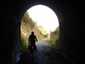 Cycling through the tunnel near Lawrence on Clutha Gold Trail